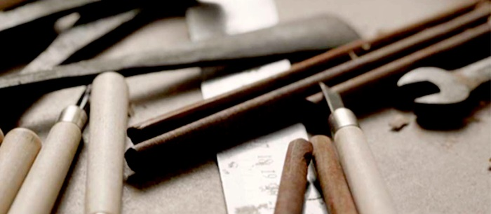 Assortment of wood working tools like chisel, hacking tools