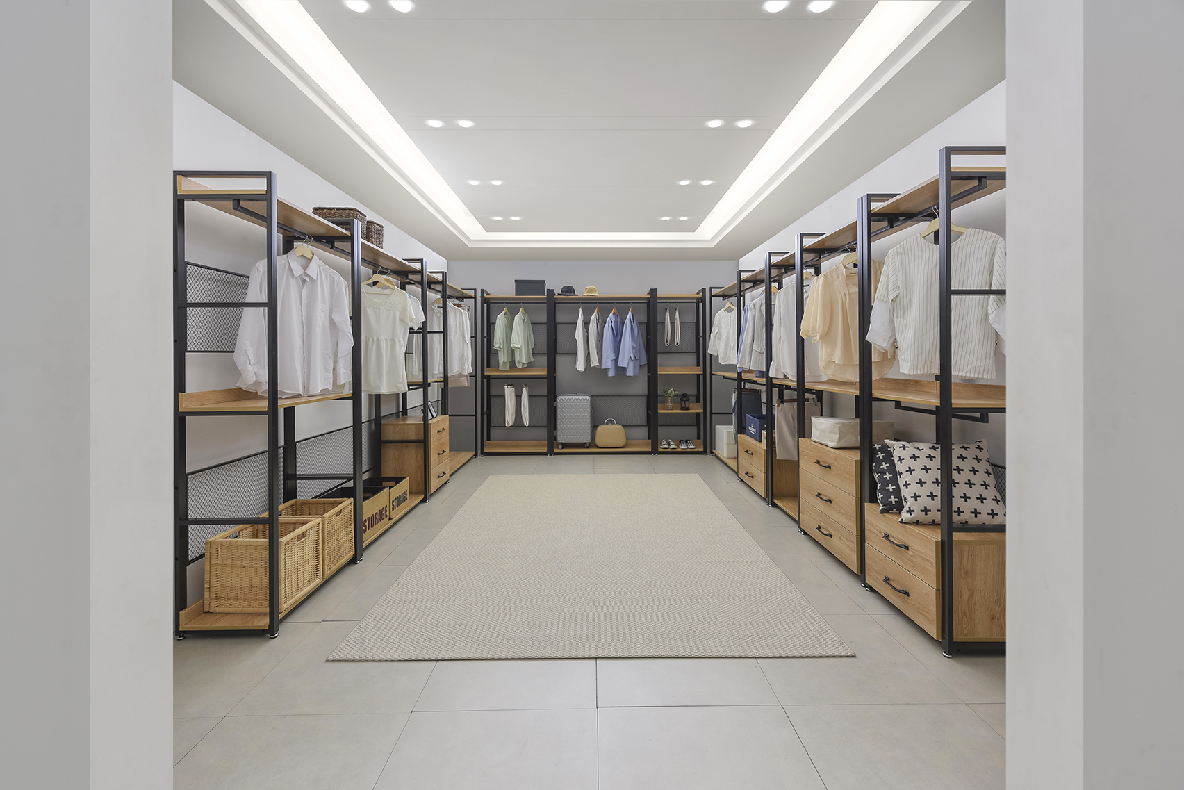 A stretch of U-shape Walk-in wardrobe built with Mila Open Modular style Wood and steel Wardrobe by Grey and Sanders