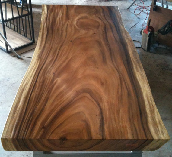 Thick slab of Suarwood, potentially trapping moisture inside due to its thickness