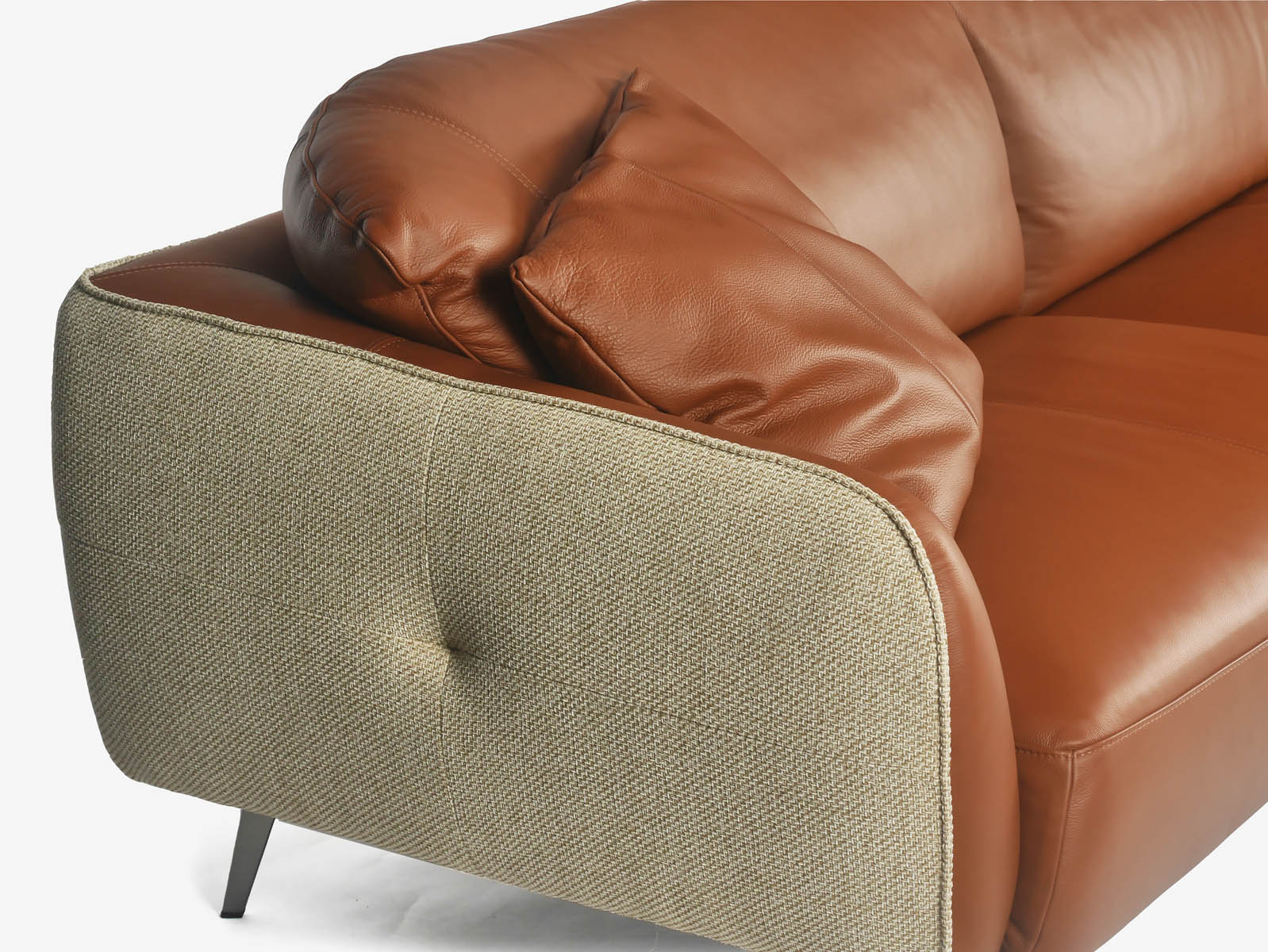 Leather and fabric sofa - Travis marries the style of both to bring you a budget friendly sofa in exquisite style, for your home furnishings.